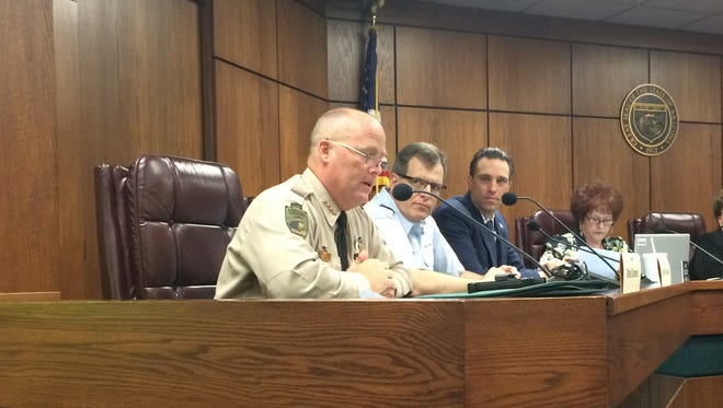 Cochise County Sheriff Mark Dannels, left, explains to the Joint Border Security Advisory Committee how he'll spend about $220,000 in private donations.
