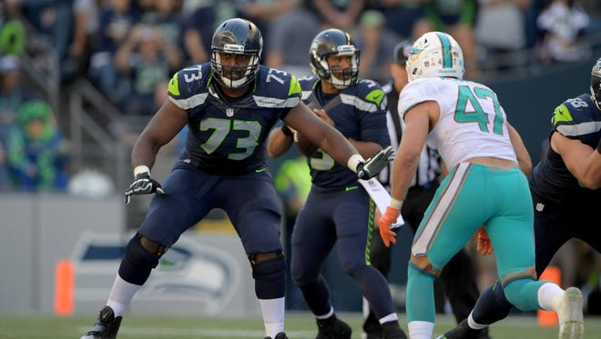 Seattle Seahawks offensive tackle J'Marcus Webb (73) plays against Miami Dolphins linebacker Kiko Alonso (47) during a NFL game at CenturyLink Field. The Seahawks defeated the Dolphins 12-10.