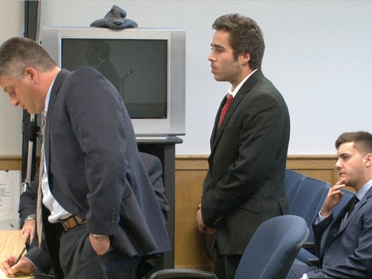 Nicholas Formica stands behind his attorney Jason Volet while Christopher Tilton looks in the Manasquan municipal courtroom Tuesday, June 14, 2016, during their trial for offering autistic Parker Drake $20 and two packs of cigarettes to jump off the Manasquan jetty in February of 2015,