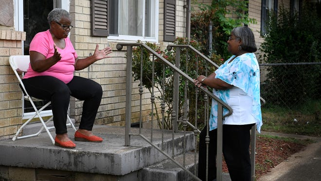 Mary Robertson talks with Ruby D. Baker in the Bordeaux Hills neighborhood Monday, July 24, 2017.