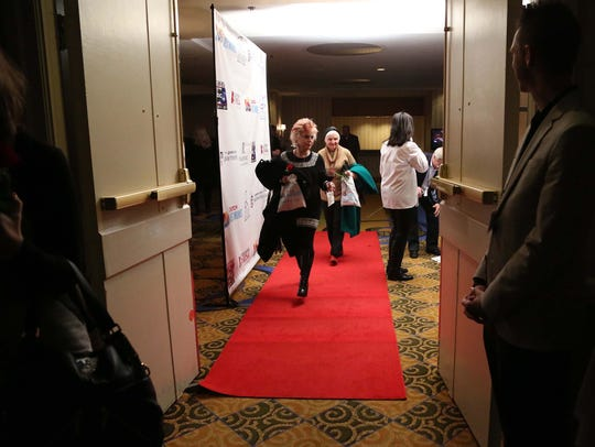 "A group of people enter The Bachelor Red Carpet Watch Party was held at the Renaissance Des Moines Savery Hotel in 2014. An episode of the reality show ""The Bachelor"" was filmed at the hotel."