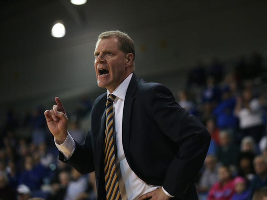 Drake coach Jeff Rutter calls out to his team during the Drake men's basketball game against Evansville on Sunday, Jan. 8, 2017, in the Knapp Center. The Bulldogs edged Evansville 88-76.