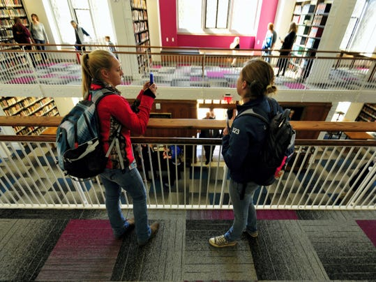 Samantha Waterhouse, left, takes a smartphone photo with fellow student Adele Reincehl on Friday during a tour of the newly remodeled John Stewart Memorial Library at Wislon College.