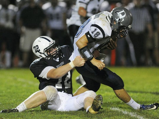 West York's Nick Kniery, left, sacks Dallastown quarterback Cade Gold during the Wildcats' 21-20 victory last season. Kniery has graduated, but Gold and the Wildcats will try to replicate last year's win when the teams square off at 7 p.m. Friday at Dallastown. You can watch the game live at GameTimePA.com.