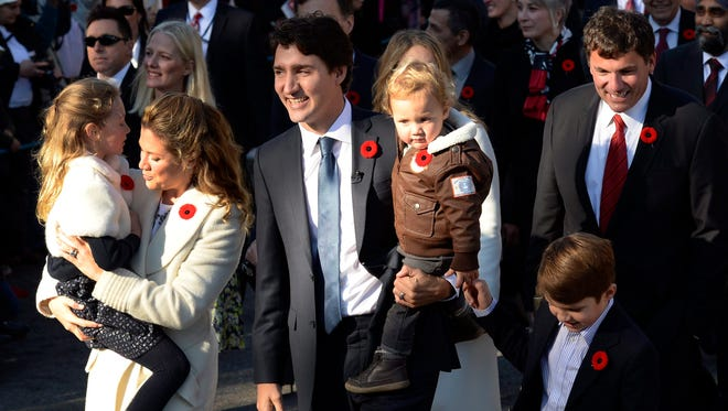Prime Minister-designate Justin Trudeau, his wife Sophie Gregoire-Trudeau and their children Ella-Grace, Hadrien and Xavier lead the new Liberal cabinet to Rideau Hall in Ottawa on Wednesday, Nov. 4, 2015.
