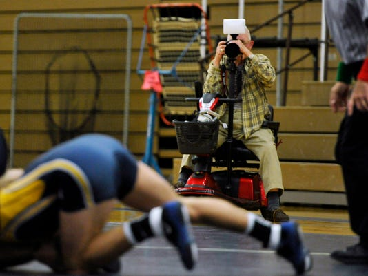 Dwaine Gipe takes photographs of the York College wrestling match at Lycoming College Tuesday, November 12, 2013.