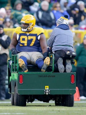 Green Bay Packers nose tackle Kenny Clark (97) is carted off the field after an injury during the 4th quarter of the Green Bay Packers 23-0 loss to the Baltimore Ravens at Lambeau Field in Green Bay, Wis. on Sunday, November 19, 2017.