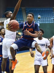 Callaway's Daeshun Ruffin (24) drives the lane against