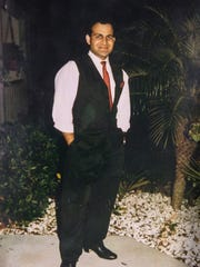Tariq Hussain, of Vero Beach, was murdered in 1995 by Lanadieal Ashe, of Fort Pierce, who was a juvenile at the time of the crime. This photograph is stored with other evidence from the case with St. Lucie County Clerk of the Circuit Court Joseph Smith.
