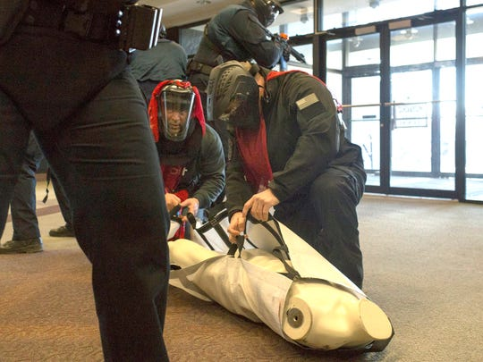 Officers go through the first drill of the OakTac or Oakland Country Tactical Response Group active shooter training on Thursday, March 22, 2018, in Southfield. Officers will go through four different types of drills focusing on an active shooter situation.