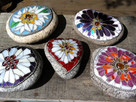 """A selection of mosaic stones handcrafted by Kathryn Boylston, of Evergreen, Colo. Boylston, an interior and garden designer, says this is an easy and fast craft that anyone can do in a few hours. """"It's just a pretty little thing to have in your garden,"""" Boylston says."""