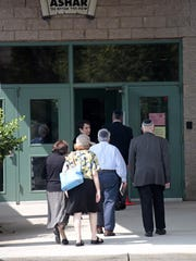 Hundreds gather for the funeral for Rabbi Nucham Muschel, 90, former dean of ASHAR and Rockland Community College trustee, at the Adolph Schreiber Hebrew Academy of Rockland in New City on July 5, 2015.