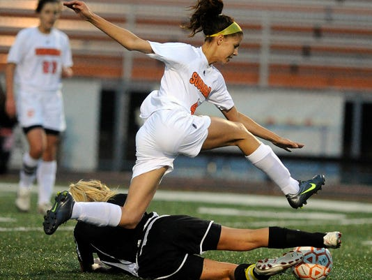 Monday night's YAIAA tournament quarterfinal game between York Suburban and Red Lion got physical. The Trojans led, 1-0, at halftime. (Daily Record/Sunday News -- Jason Plotkin)