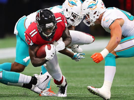 Atlanta Falcons wide receiver Julio Jones makes a first down catch against the Miami Dolphins during the first half of an NFL football game Sunday, Oct. 15, 2017, in Atlanta. (Curtis Compton/Atlanta Journal-Constitution via AP)