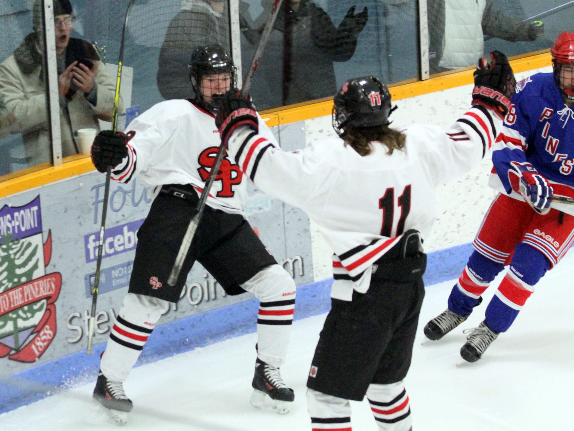 Stevens Point Area Senior High sophomore Brock Caufield, left, hopes to be celebrating a spot on the U.S. National Under-17 Team as part of USA Hockey's National Team Development Program in the next month.