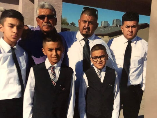 Frank Pineda (back row, second from right) was killed at his Surprise residence Friday after an altercation with a repairman.