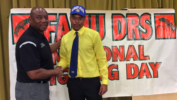 Alongside FAMU DRS athletic director Terrence Milton,