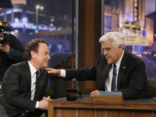 """Jay Leno, right, with guest Billy Crystal during a commercial break during Leno's final show as host of """"The Tonight Show"""" on Thursday, Feb. 6, 2014, in Burbank, Calif. (Gary Friedman/Los Angeles Times/MCT)"""
