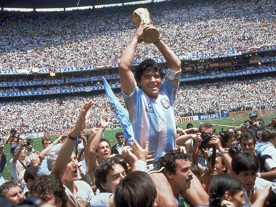 Diego Maradona, holds up the trophy, after Argentina beat West Germany 3-2.