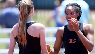 Ensworth's Tyra Gittens, right, reacts to her teammate, Jenna Rolfe, left, after Rolfe cleared a high bar on the high jump during the Spring Fling Girls Outdoor Pentathlon in 2016.
