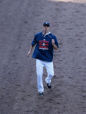 Tigers pitcher Joe Nathan, on the 15-day disabled list, works out in the outfield during batting practice before the Tigers baseball game against the Chicago White Sox on Saturday in Detroit.