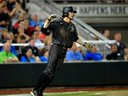 Vanderbilt's Dansby Swanson reacts after scoring a run against Virginia during the 7th inning in the College World Series at TD Ameritrade Park, Monday, June 22, 2015, in Omaha, Neb.