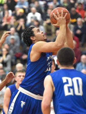 Cedar Crest's Raymie Ferreira goes up for two against