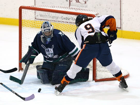 Two co-op programs, Mountain Lakes/Boonton and Morris Catholic/DePaul/St. Elizabeth, compete in an ice hockey matchup at Mennen Arena on Nov. 30, 2017.