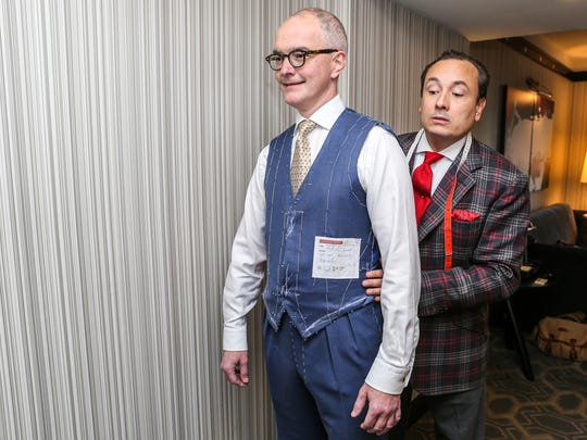 Savile Row master tailor Steven Hitchcock, right, takes