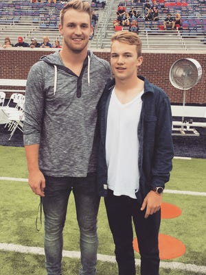 Former Giles County and Ole Miss quarterback Bo Wallace, left, will coach his youngest brother Bryce as an assistant at Marshall County.