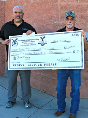 David Almaguer, left, and Jim Hash, of the Fraternal Order of Eagles, Aerie 4038, presented a check for $1,000 to the Shattered Lives of Doña Ana County in March 2018.