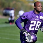 Minnesota Vikings running back Adrian Peterson makes his way off an NFL football practice field at Winter Park in Eden Prairie, Minn., Friday, Oct. 11, 2013. Peterson said he is certain he will play Sunday despite a serious personal matter that caused him to miss practice earlier this week.