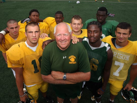 John Herrington poses with some of his top players on the 2010 team before practice Aug. 17. Left to right: Steve Slobin, Tom Vento (10), Evan Patton, Derek Head, Lido Zefi, Aaron Burbridge, Mario Ojemudia, and Kristian Malaj.