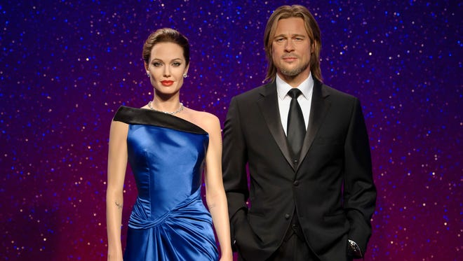 """This 2013 photo released by Madame Tussauds shows wax figures resembling married actors Angelina Jolie Pitt, left, and Brad Pitt on display at a Madame Tussauds wax museum. The couple's pending divorce has prompted Madame Tussauds to separate the wax figures of the stars at their museums in London, New York, Las Vegas and Hollywood. The London museum's head of marketing, Nimali Weerasinghe, says that they wanted to mirror Jolie and Pitt's separation in the attraction. She says the wax figures """"are now featured at a respectful distance from each other."""""""