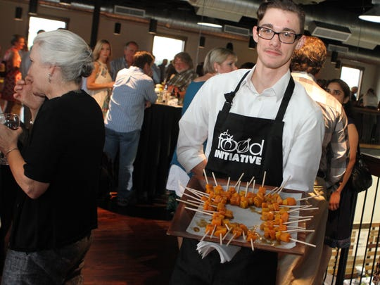 The Food Initiative servers greet guests at a previous farm-to-table fundraiser with appetizers, like these butternut squash skewers drizzled with a basil infused honey. The sixth annual Fine Fettle is Sept. 28.