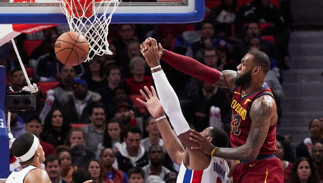 Cleveland Cavaliers forward LeBron James (23) blocks a shot by Detroit Pistons center Andre Drummond (0) in the second half at Little Caesars Arena.