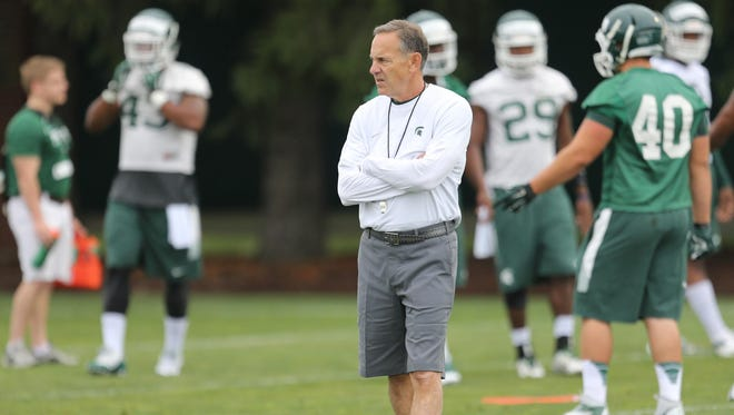 Michigan State Spartan head coach Mark Dantonio watches defensive drills during practice on Saturday, August 8, 2015 at the Duffy Daugherty football building in East Lansing Michigan.