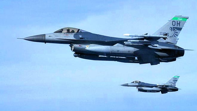 Ohio Air National Guard F-16C jets with the 112th Fighter Squadron in Toledo escorted a Sunwing Airlines aircraft back to Toronto on July 25, 2014, after a threat from a passenger.