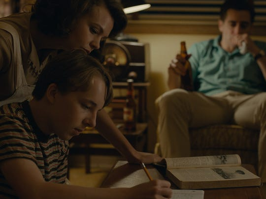 Jeanette (Carey Mulligan, left) gets a part-time job to help support her son, Joe (Ex Oxenbould), when husband Jerry (Jake Gyllenhaal) is out of work.