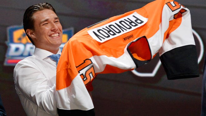 Jun 26, 2015; Sunrise, FL, USA; Ivan Provorov puts on a team jersey after being selected as the number seven overall pick to the Philadelphia Flyers in the first round of the 2015 NHL Draft at BB&T Center. Mandatory Credit: Steve Mitchell-USA TODAY Sports