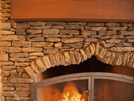 This traditional masonry fireplace is stacked Arkansas