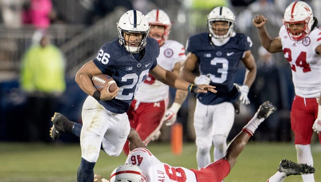 Penn State running back Saquon Barkley dodges the tackles from Nebraska defensive back Joshua Kalu Saturday, Nov. 18, 2017 in State College, Pa. Penn State won over Nebraska 56-44. (Abby Drey/Cetre Daily Times/TNS)