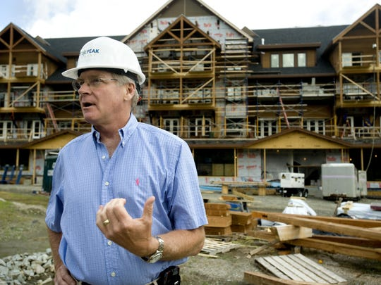 Jay Peak Resort owner and president Bill Stenger tours construction of the resort's hotel, restaurant, spa and equipment facilities in 2009.