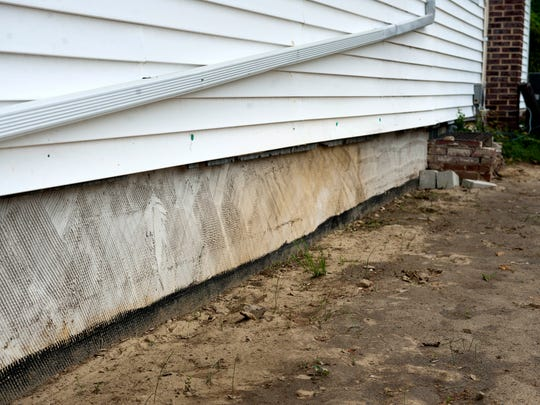 This newly repaired wall, a foundation wall, gave way, causing massive damage, during severe rains last summer at Mount Calvary Union Church in Runnemede, seen here on Thursday, May 8, 2014. The church was just recently able to reopen after repairs were made through fundraising and volunteer efforts.