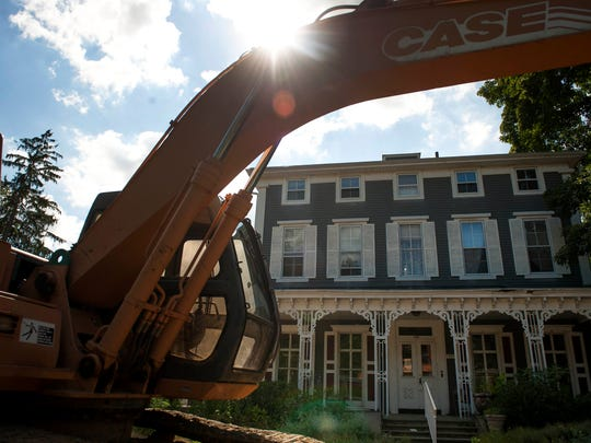 A backhoe sits in front of Brandywine Senior Living at Haddonfield, the under-construction future assisted living site on Warwick Road in Haddonfield on Thursday, July 24, 2014. The historic building dates back to the early 1800's.