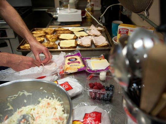 Tommy McGovern prepares monte cristo sandwiches for his Ladder 24-C Platoon crew in Cherry Hill on Wednesday, August 28, 2014. McGovern is a trained chef and prepares most of the meals for his crew.