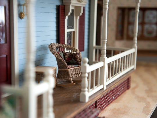 Winnie Lucchesi shows off the elaborate Victorian-style dollhouse built by her mother, at her Cherry Hill home on Thursday, August 21, 2014. The house began as a kit which her mother customized with accents such as wallpaper, opening stained glass, woodwork details and custom furniture and accesories.
