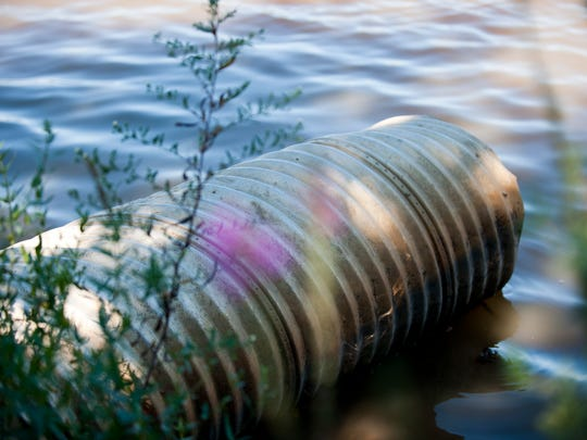 A drain outfall pipe is seen at Cooper River Park, Friday, September 26, 2014 along the water's edge in Collingswood.