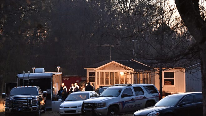 Law enforcement officials execute a search warrant earlier this month at a residence in the Redwood community of Vicksburg, the home of one of the two Warren Central Junior High students detained after a bomb threat at the school. A suspected explosive device was found at the school and rendered safe by Clinton Police Department's bomb squad and an FBI bomb technician.