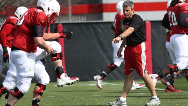 Louisville assistant coach Chris Klenakis observes a practice in 2016.